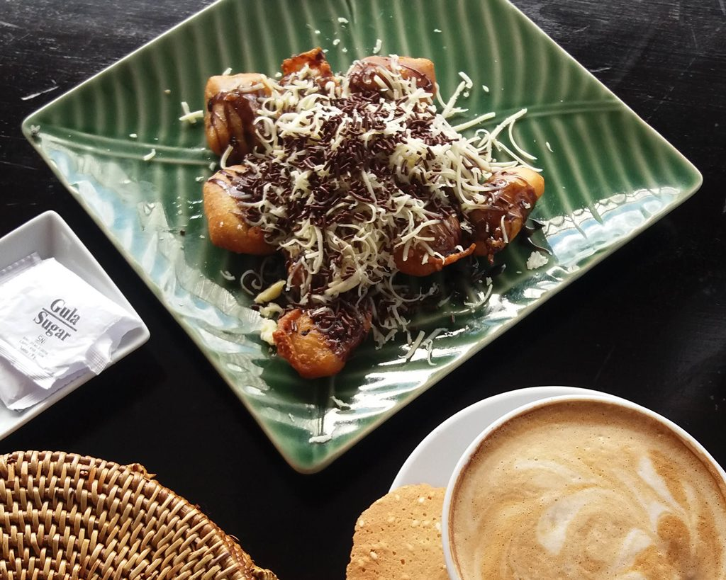 Breakfast with coffee and Balinese dessert Pisang Goreng