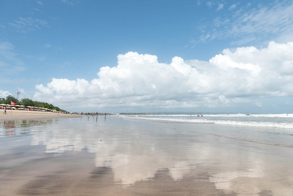 Reflection of the clouds on the wet sand in Legian - Bali, Indonesia