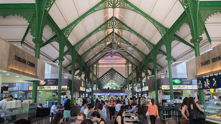 Several people eating at the Telok Ayer Hawker Centre in Singapore