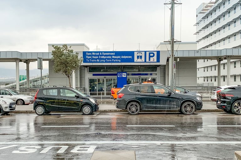 Main entrance of the Athens International Airport metro station on a rainy day
